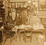 "OHS ""rooms"" in Portland City Hall, 1913. George Himes at left, John S. Greenfield (his assistant) third from left"