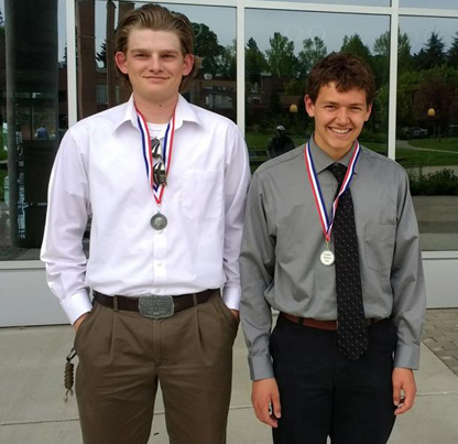 Drew Nelson, left, and Colton Reynolds pose with their medals after the statewide National History Day competition. Photo contributed by Lorin Kubishta.