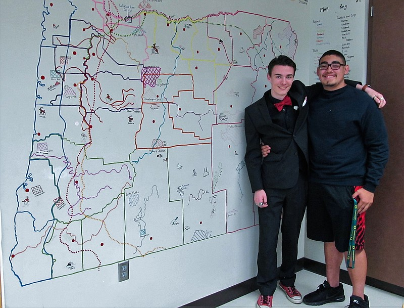 Ilias Lawson, left, and Victor Ochoa pose in front of Kassidy Nelson's map of Oregon in Frank White's classroom. Photo by Audrey Caro, Polk County Itemizer-Observer