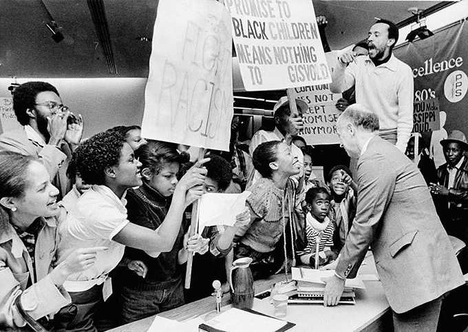 1982 Black United Front members protest at a school board meeting in Portland. OHS Research Library, OrHi 95005