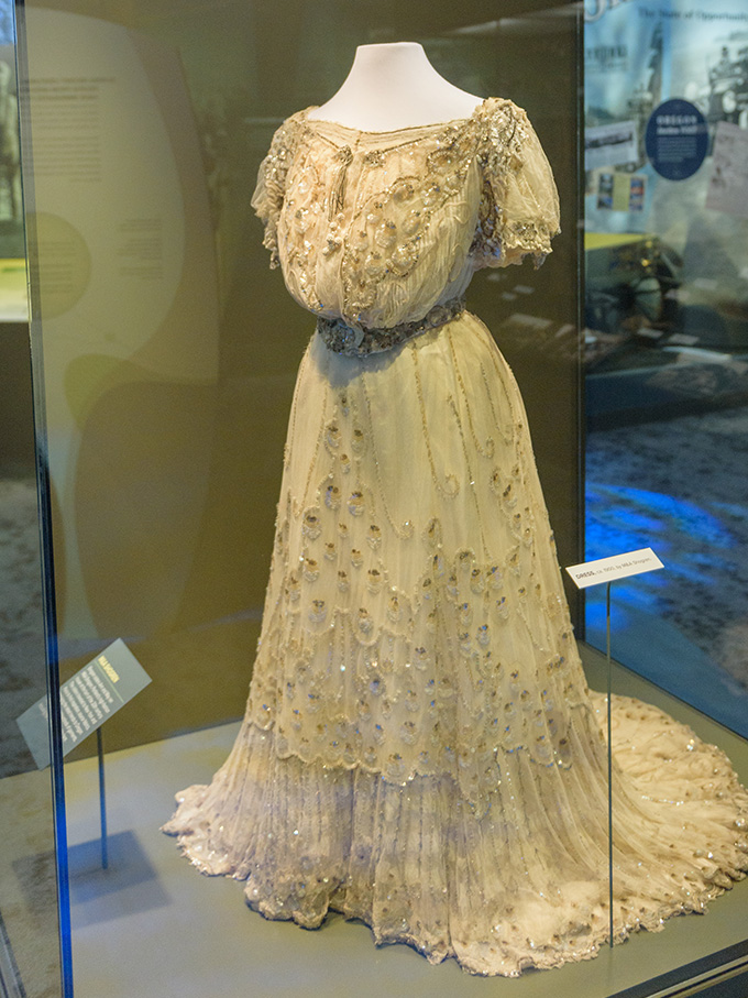 "Shogren dress on display in 2019 in OHS's ""Experience Oregon"" exhibit. OHS Museum 86-181.1.1,.2. Andie Petkus Photography."