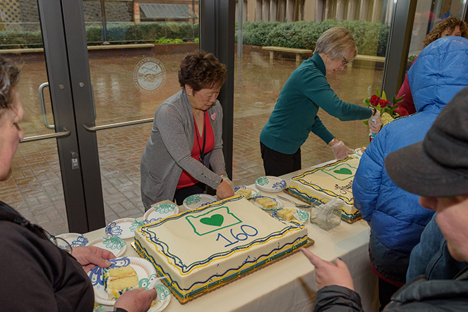 Volunteers Janet Lee and Martha Shepherd serve cake to visitors on Oregon's 160th birthday.