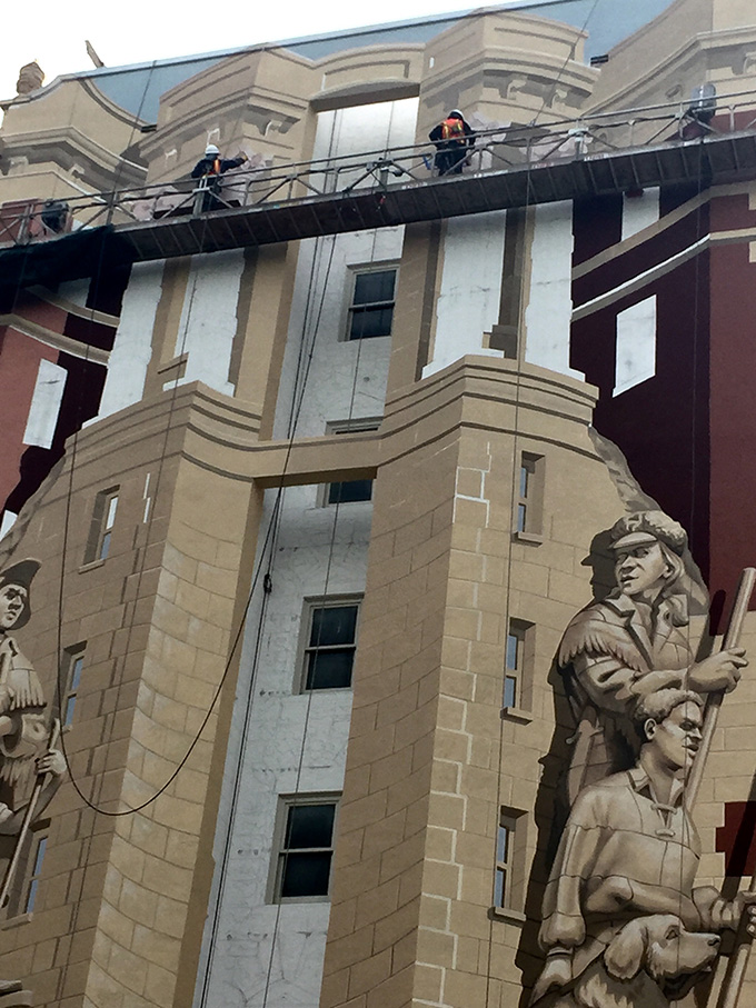 Dan Cohen and his team at work repainting the westward facing mural on the Sovereign building, 2016. Photo by Rachel Randles