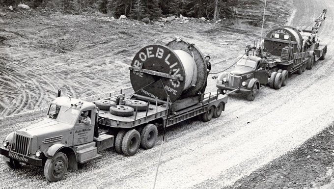 Roebling cable being hauled up Timberline Highway for use on Mt. Hood Skiway, OHS Research Library, Org. Lot 1027, Oregon Journal photographs collection, 1902–1982