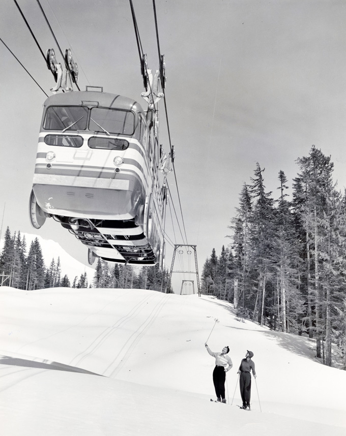 Skiers on Mt. Hood below Skiway tram, photographer Ray Atkeson, OHS Research Library, Org. Lot 1027, Oregon Journal photographs collection, 1902–1982