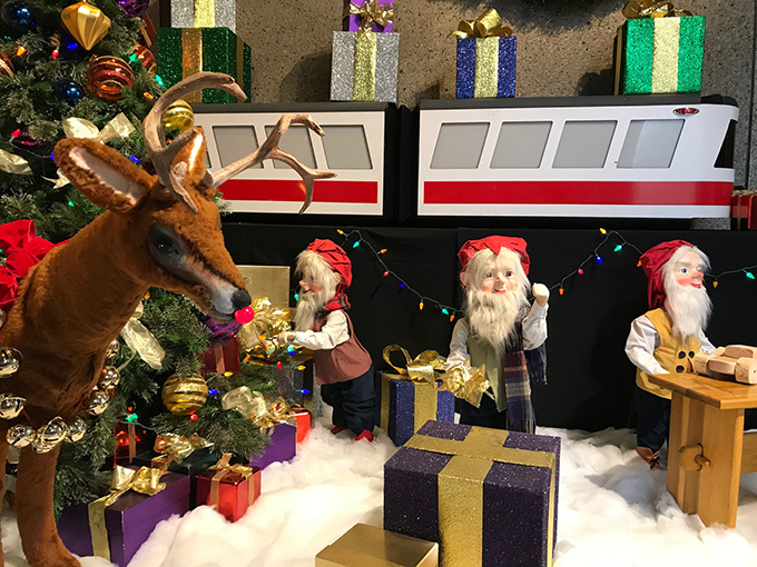 Rudolph and three elves greet visitors at OHS's Santaland in 2018. Photo by Rachel Randles.