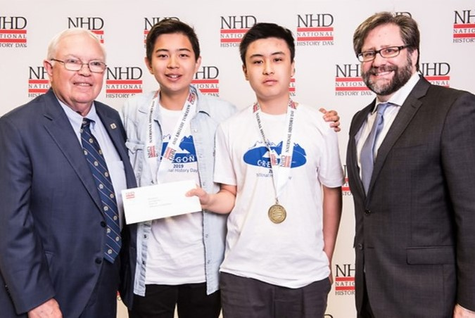 Kyler Wang and Alan Zhou receive their first place prize for their Senior Group Documentary at the 2019 National History Day® contest.