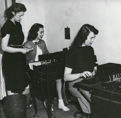 In 1948, June Ellertson, Pat Doolittle, and Virginia Laursen operate punch cards for the state system of higher education. OHS Research Library, CN 005247.
