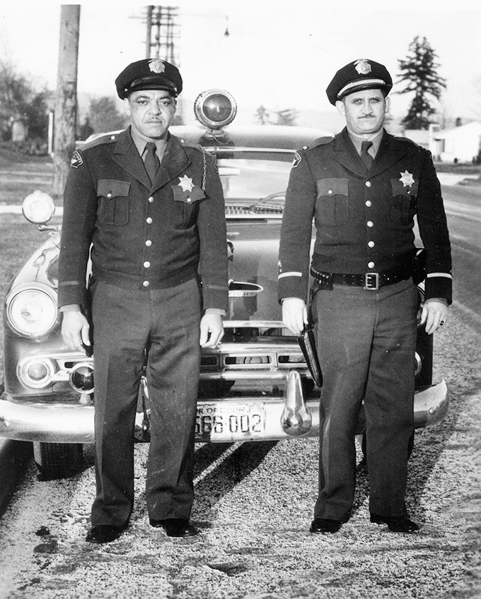 Portland police officer Bill Travis (left), one of the first deputy sheriffs hired to patrol Vanport City during the 1940s. OHS Research library, 25465.
