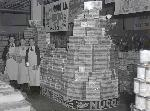 Thriftway employees stand next to Nucoa margarine packages between 1933 and 1941. OHS Research Library, Oregon Journal Negative Collection, Org. Lot 1368, box 372, 372A0983