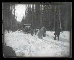 Bus passengers(?) clearing snow on route between Portland and The Dalles, 1925–1926, Oregon Journal Negative Collection, Org. Lot 1368, Box 376, 376G0096