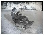 Unidentified boy and dog on sled, ca. 1923–1936, Oregon Journal Negative Collection, org. lot 1368, box 377, 377N0187