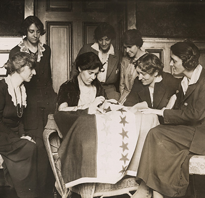 Alice Paul sews stars on flag to represent each state as it ratifies the 19th Amendment, 1920, Library of Congress, LC-F8- 7084 [P&P], National Photo Company Collection