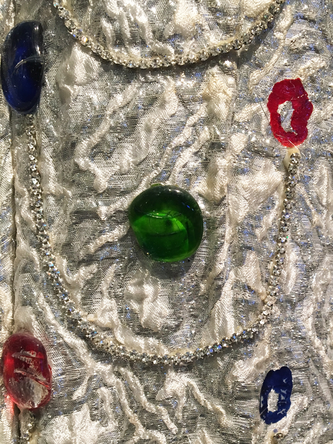 Detail showing marbles glued to the fabric of the dress. Photo courtesy of Erin Brasell.
