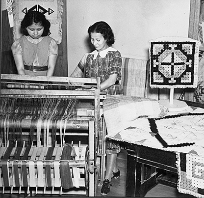 Girls weaving on looms at the Chemawa Indian School, 1937, bb003867