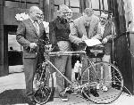 McCall signs the Bicycle Bill, 1971. Don Stathos is left of McCall Photo property of the Stathos family
