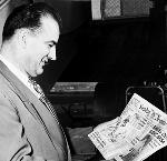 Senator Joseph McCarthy with editorial cartoon on front page of the Oregon Journal newspaper, bb003156