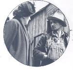 Gertrude Jensen speaks with Delbert Palmer, a logger near Mist Falls, in April 1952. OHS Research Library, 63424