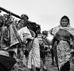An older Rohingya woman is carried by family members to their hut in the refugee camps in Bangladesh. Most Rohingya spent days and sometime weeks walking from their destroyed villages in Myanmar to the border of Bangladesh. Copyright Greg Constantine