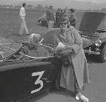 Two women with sports car at auto races in Tillamook, June 1955. OHS Research Library, Oregon Journal Negative Collection; Org. Lot 1368; Box 372; 372A1237