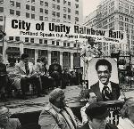 "After a black student was beaten to death by skinheads in 1989, City Commissioner Dick Bogle organized a ""City of Unity Rainbow Rally"" in Portland Pioneer Square. OHS Research Library, The Skanner photographs collection, Org. Lot 1286; bd000443"