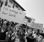 Hundreds of youth from the Buddhist Rakhine community chant racist, anti-Rohingya slogans at a demonstration in Sittwe in late 2014. Copyright Greg Constantine