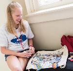 Oregon student collects buttons at 2019 National History Day contest.