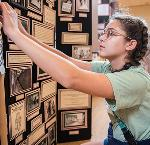 Student makes finishing touches on 2019 National History Day exhibit.