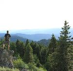 Hiker at Soda Mountain, View of Pilot Rock. (Cropped) Bureau of Land Management Oregon and Washington, CC BY 2.0