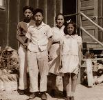 Mitzi Loftus with her family at the Tule Lake Internment Camp. (McMenamins)