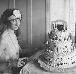 Daughter of Oregon pioneers Katherine Kubil cuts Oregon's 64th birthday cake, 02-26-1923, Oregonian collection, Orig 0318P485, Neg No. 009818