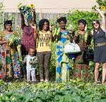 Swahili women's group celebrates at the community garden; courtesy African Family Holistic Health Organization
