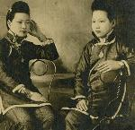 Two Chinese Girls in Traditional Chinese Dress and Western Boots, Portland, OR, ca 1905