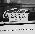 Luncheonette Sign, We Cater to White Trade Only. Across the street from the Kenton Theater, North Portland, c. 1943. Jon Tuttle Collection, CN 0034, ba018361