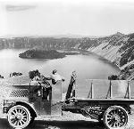 Crater Lake Company Mack Truck, Wizard Island in background, 1921, Benjamin Gifford Collection, Gi 10937-b