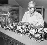 Scale model of circus baggage wagon and draft horses is displayed by wood carver Ed Quigley, March 29, 1959, Oregon Journal collection, bb016183
