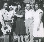"Rose Mary Villanueva with her parents, godfather ""Chap"" Cruz Campo, and her godmother Magdalena Campos on her baptism day. June 1, 1947. Courtesy Latino Roots in Oregon Project"