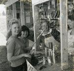 Wheel club fireworks stand at LaCenter, WA, June 30, 1960 Left to right: Cheryl Throop, Elouise Strebritz (Wheel club princess), Mrs. Charles Berkhalter and Mrs. Clare Osborne Portland Reporter Photograph Collection, Org Lot 62, Box 17, Folder 10
