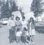 A family living at Wilson Camp L. Fidel, Maria, Maria Stella, Ophelia, Marisella (child on left) and unknown friend. Part of the Valley Migrant League Collection.