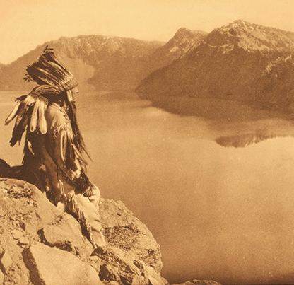 Klamath man overlooks giiwas (Crater Lake) Curtis Collection Photo provided by Taylor R. David, Klamath Tribes News Dept.