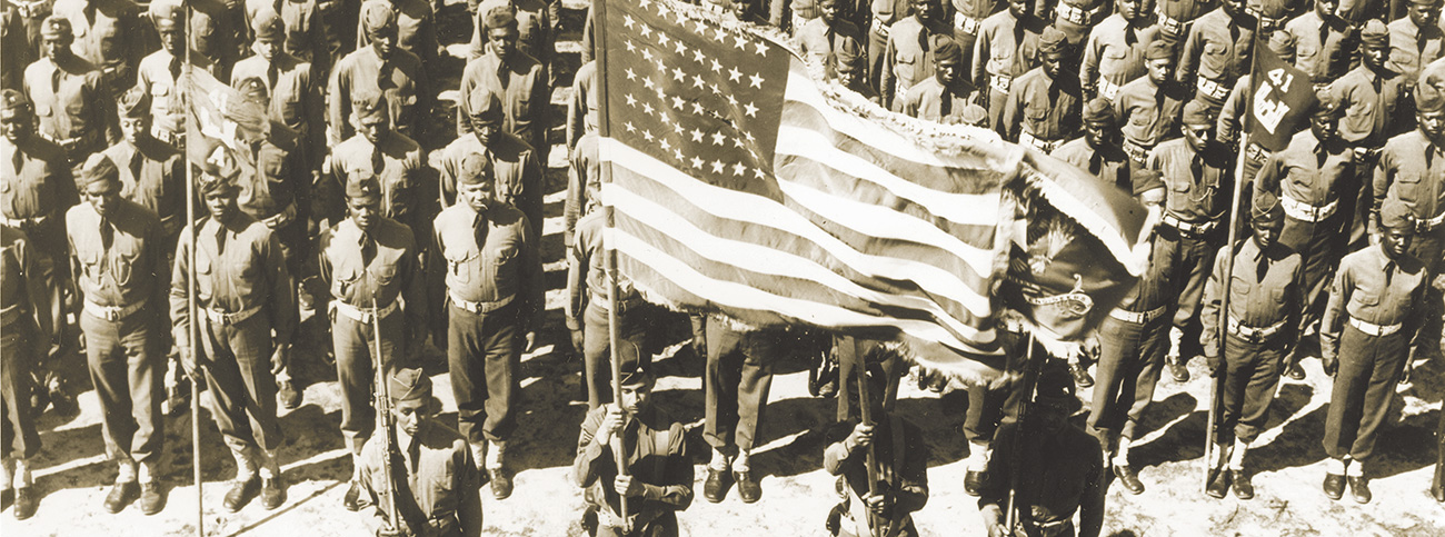 Wartime color guard ceremony of the 41st Engineers at Ft. Bragg, North Carolina. Courtesy National Archives.
