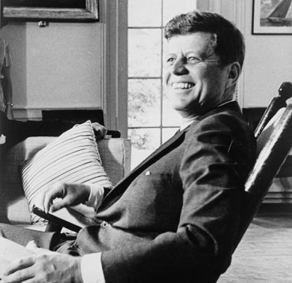 President John F. Kennedy, half-length portrait, seated in rocking chair, facing slightly left; RN: LC-USZ62-133121