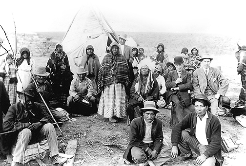 Indian agent Heinlein issues blankets, tents, and clothing to the Paiutes in exchange for their land. OrHi44161