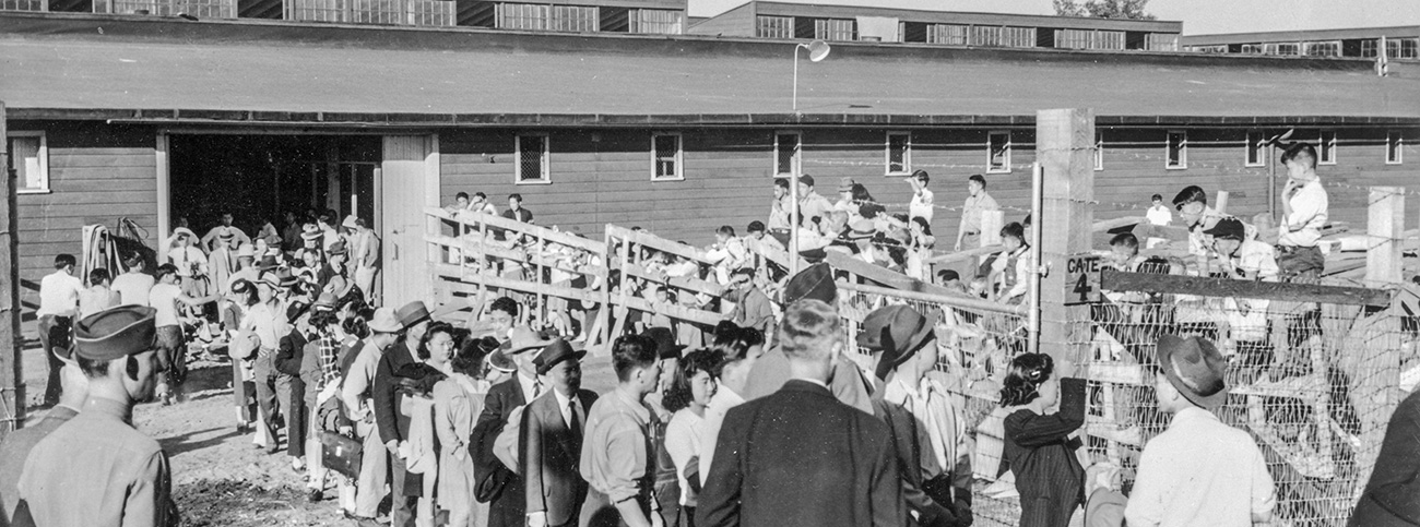 Japanese Evacuees at the Pacific International Livestock Exposition Building, being used as a Japanese American assembly center. July 8, 1942 Photo file #584. Oregon Journal Collection. OrHi 28157 bb013905