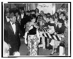 President and Mrs. John F. Kennedy greet crowd outside National Theatre; RN: LC-USZ62-133120