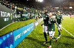 "Mamadou ""Futty"" Danso, Jack Jewsbury, and Steve Purdy celebrated a win following the Timbers first home game in the MLS era. Photographer Craig Mitchelldyer, Courtesy of Portland Timbers"