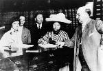 Clara Elizabeth Chan Lee registering to vote in Alameda in 1911 with Emma Tom Leung and the women's husbands; Lee was born in Oregon and was the first Chinese American woman in the U.S. to register to vote, Wikimedia Commons, public domain