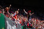 Capo Tina leads section 108 during a 2019 Portland Thorns game. Courtesy of the 107 Independent Supporters Trust.