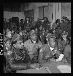 Members of the 332nd Fighter Group attend a briefing at their airbase in Ramitelli, Italy, in 1945. Library of Congress, LC-F9-02-4503-319-07