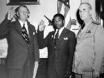 In June 1942, the US Navy began accepting black men for service outside of the steward branch. William Baldwin (center) was the first General Service recruit. National Archives, 208-NP-8B-2.